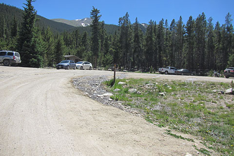 North Mount Elbert Trailhead - parking area and privy. Mount Elbert is in the background.