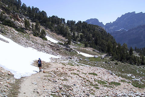 Trail climbing past snow and rocks
