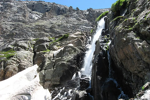 Timberline Falls cascading over rocks and snow