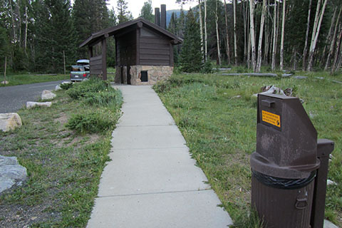 Trailhead parking and modern privies.