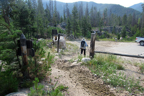 Hiker leaving the Tonahutu Trail exiting past a gate on to Rd 663.