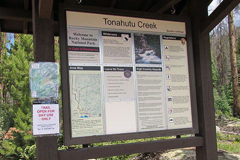 Photo of the Tonahutu Creek Trail Kiosk - filled with a map and trail information