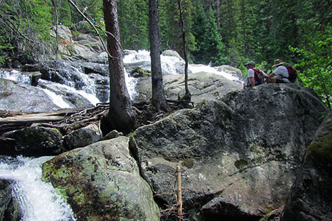 hikers at the base of Cascade Falls